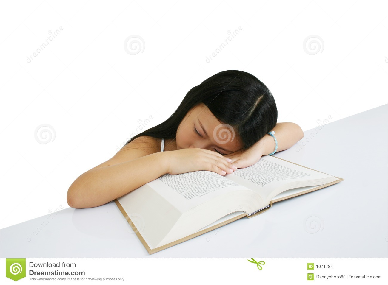 Young girl sleeping on a book