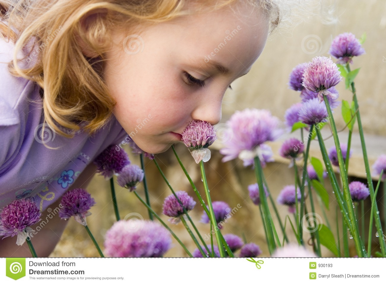 Young girl smelling flowers
