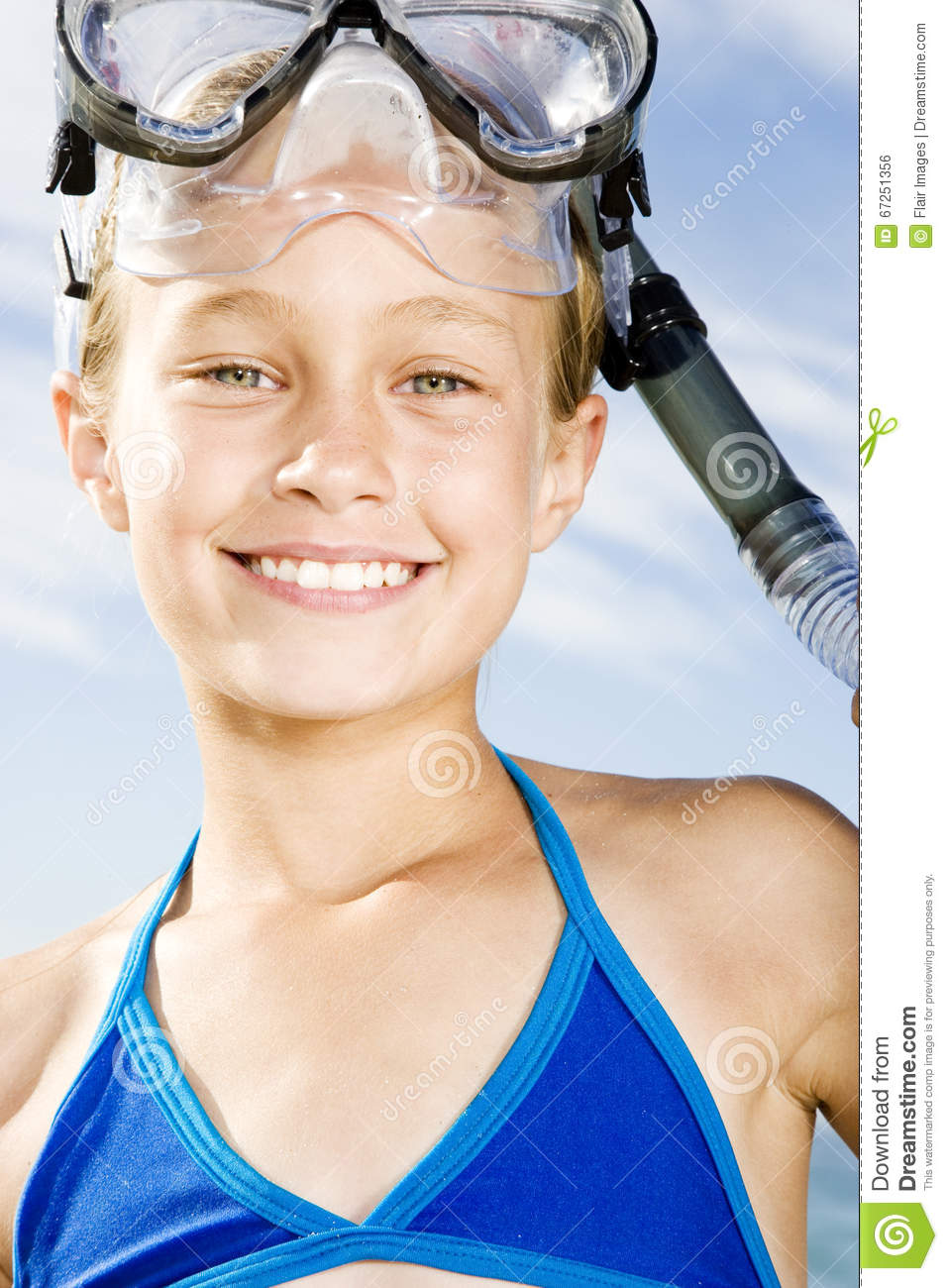 A Young Teen Girl With Long Curly Blond Hair Is Outside: A Young Girl In Snorkeling Gear Stock Photo