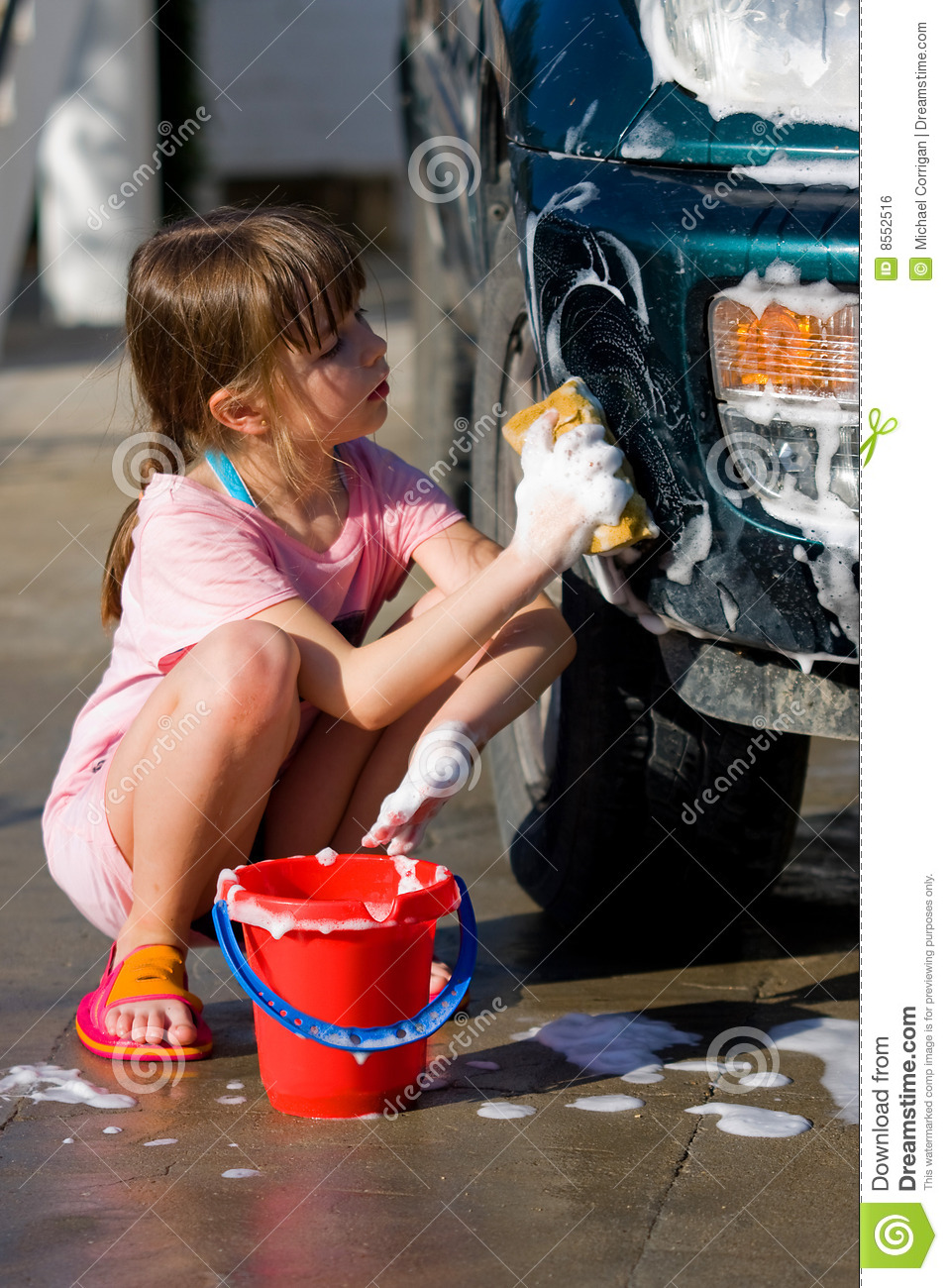 Young Girl With Soap Suds Carwash Royalty Free Stock Image