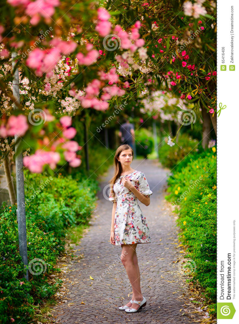 Young Girl Standing Near Tree With Flowers Stock Photo Image Of