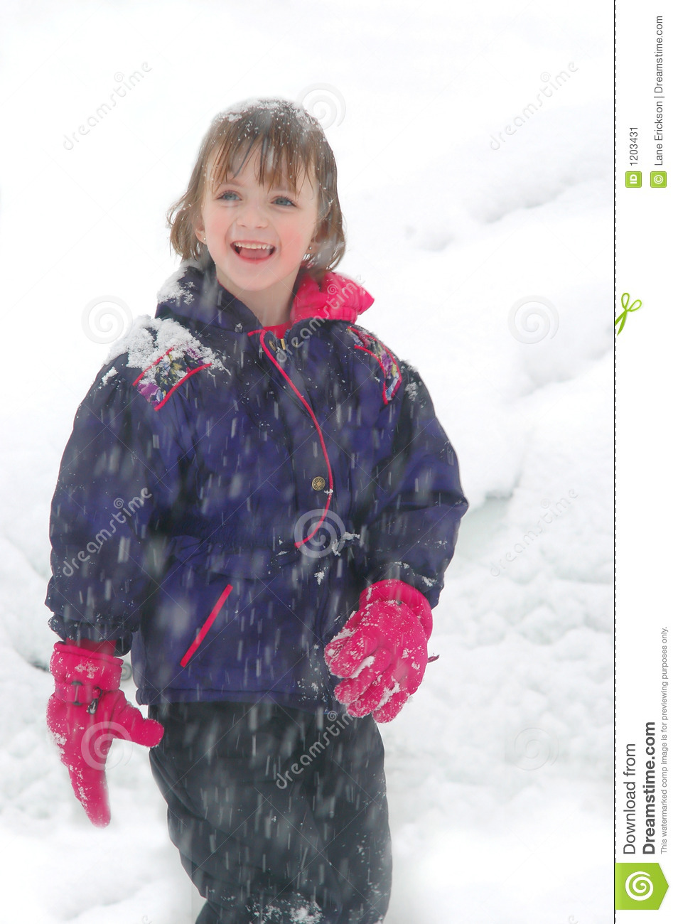 Young Girl Standing in Snow with Snow Falling