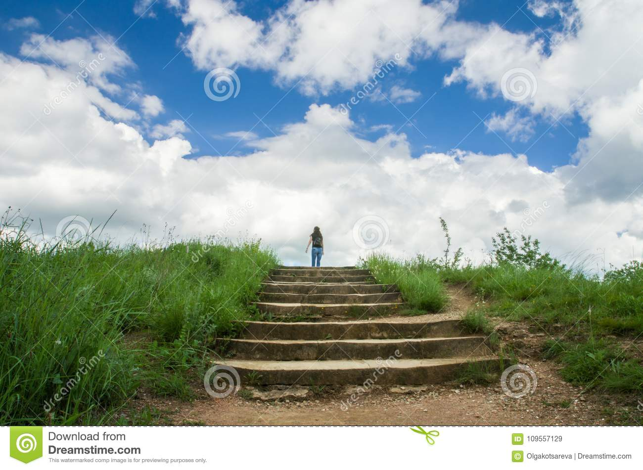 A Young Girl Stands On Top Of A Stone Staircase And Looks At The Sky