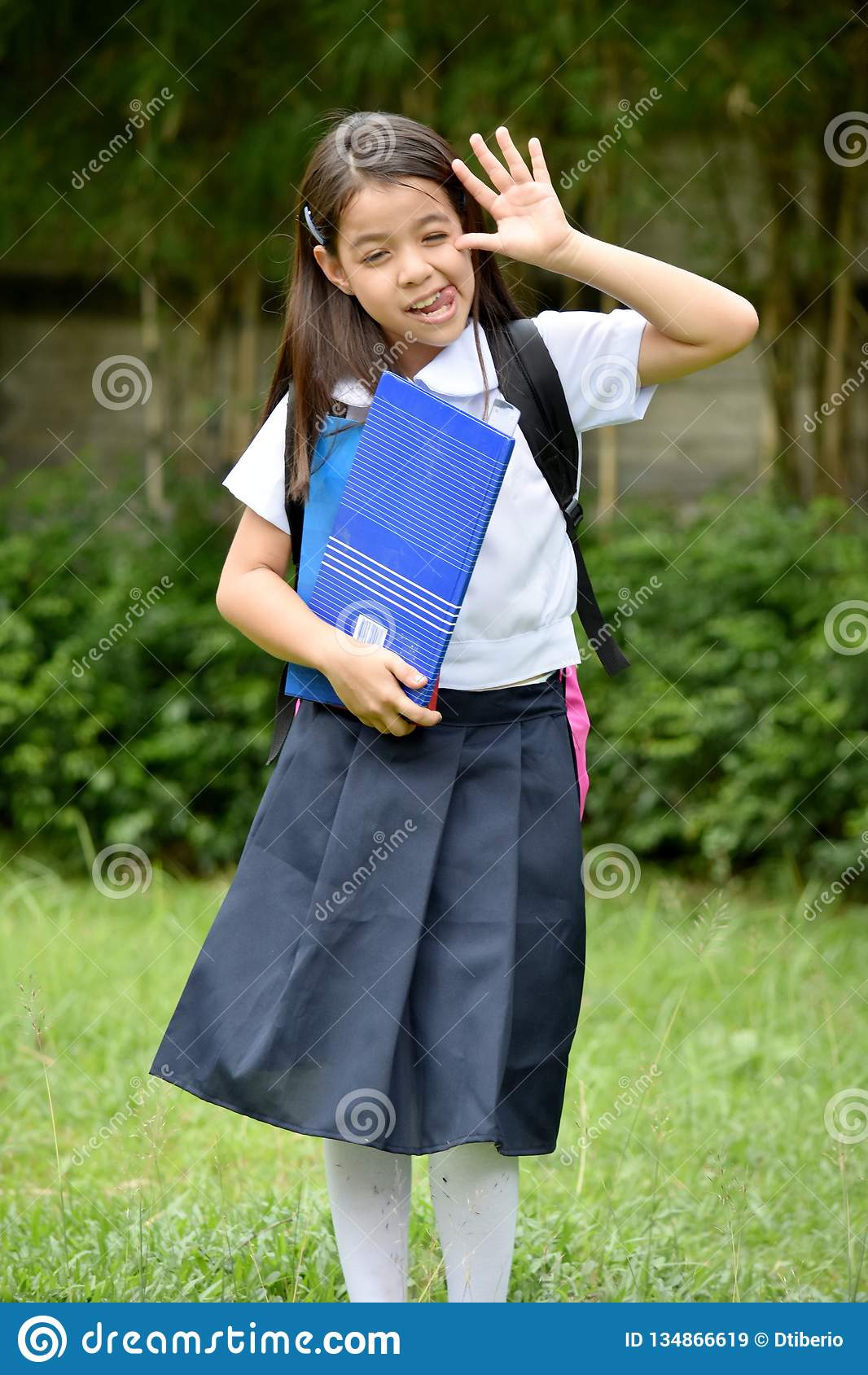Young Girl Student Making Funny Faces Wearing School Uniform