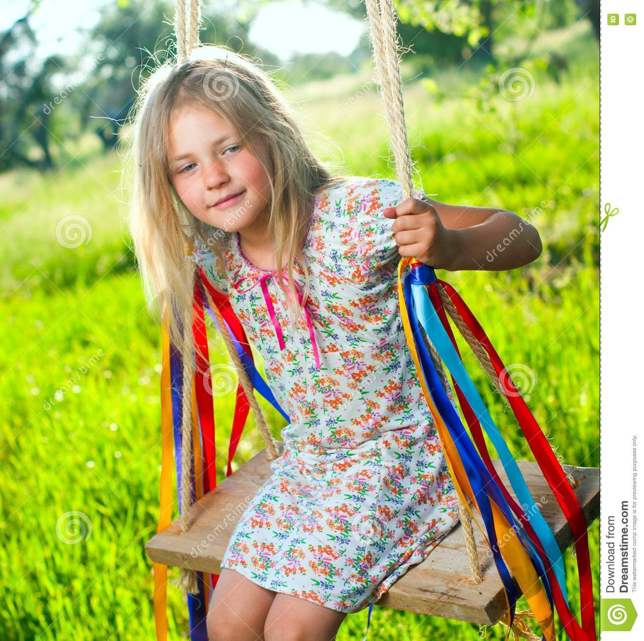 Young girl on swing.