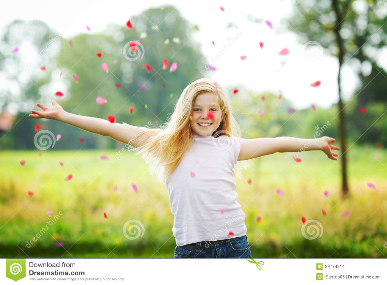 Young girl throwing petals