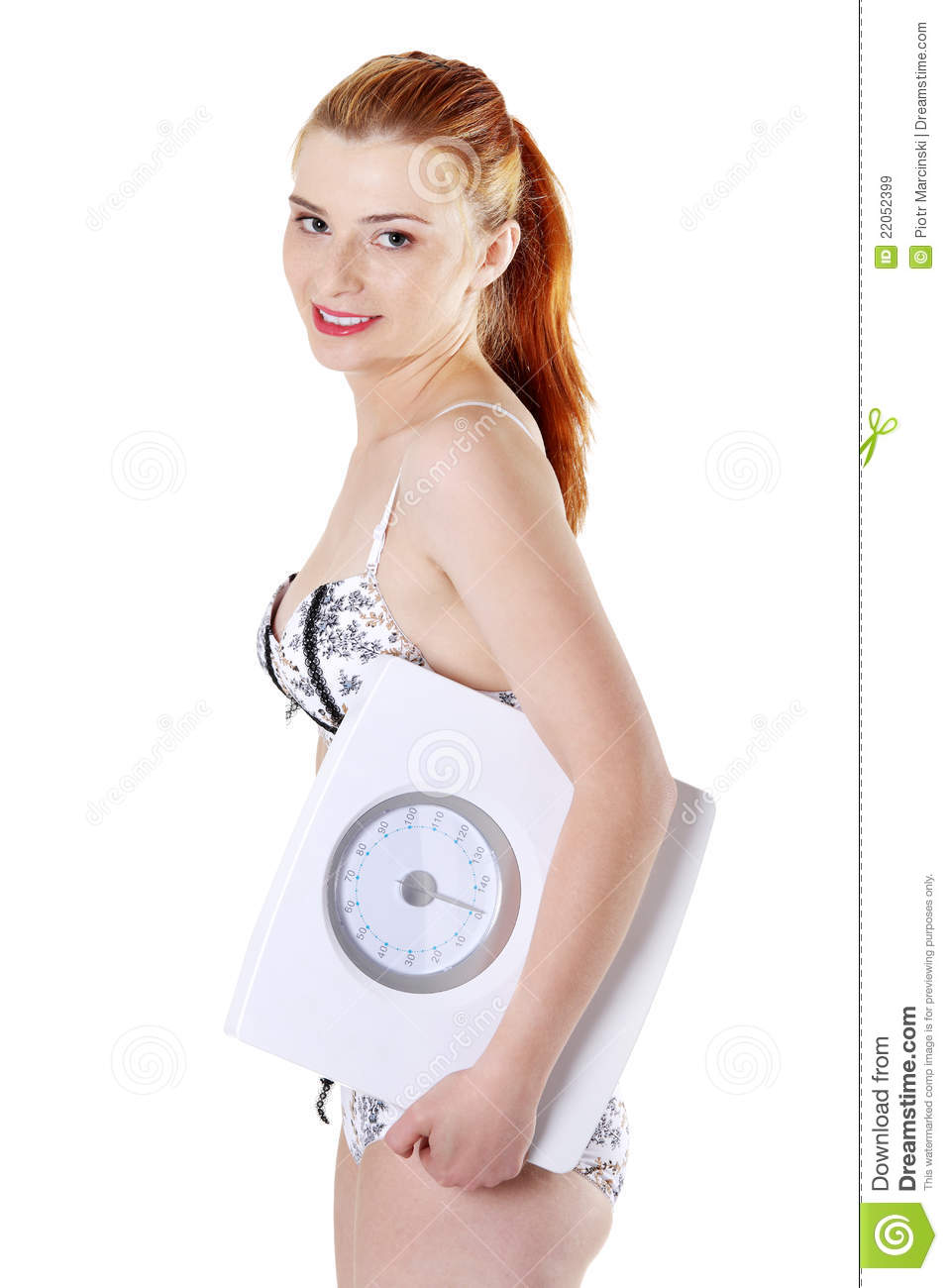 young girl underware Young girl in underwear holding a scales