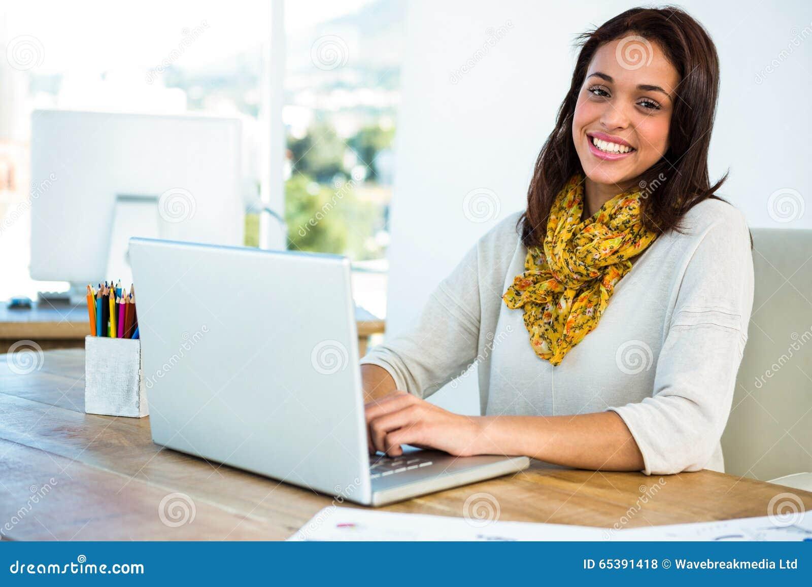 Young girl uses his computer
