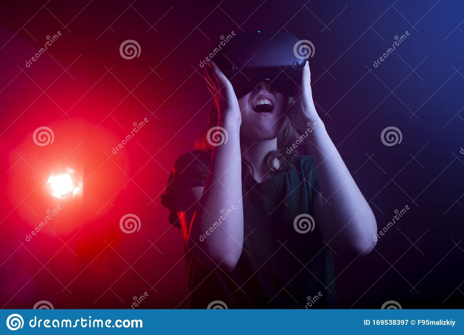 The VR experience. Pretty girl in virtual reality headset