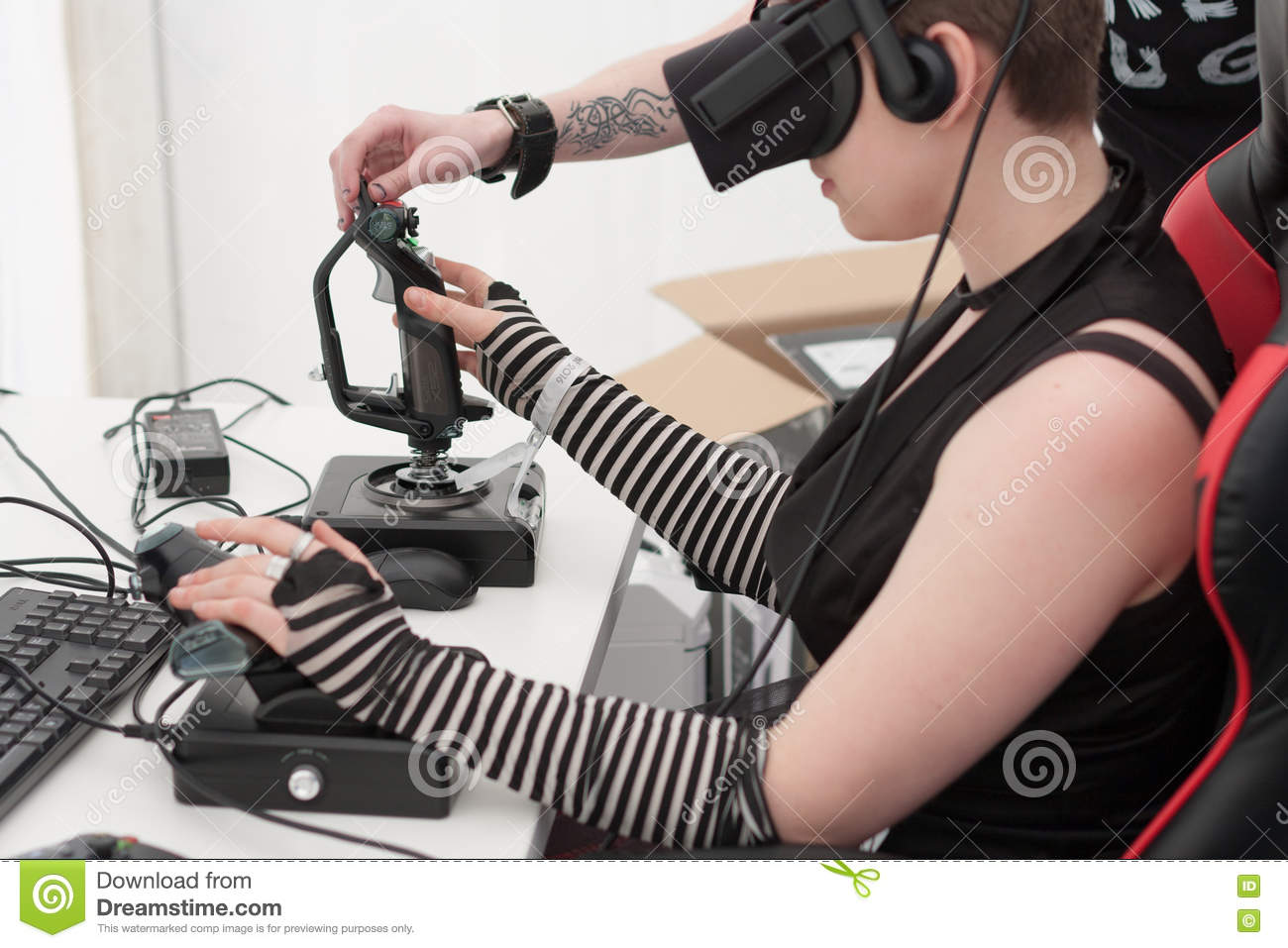 3eba5476543 Young Girl With VR - Glasses Plays Game On PC At Animefest Editorial ...