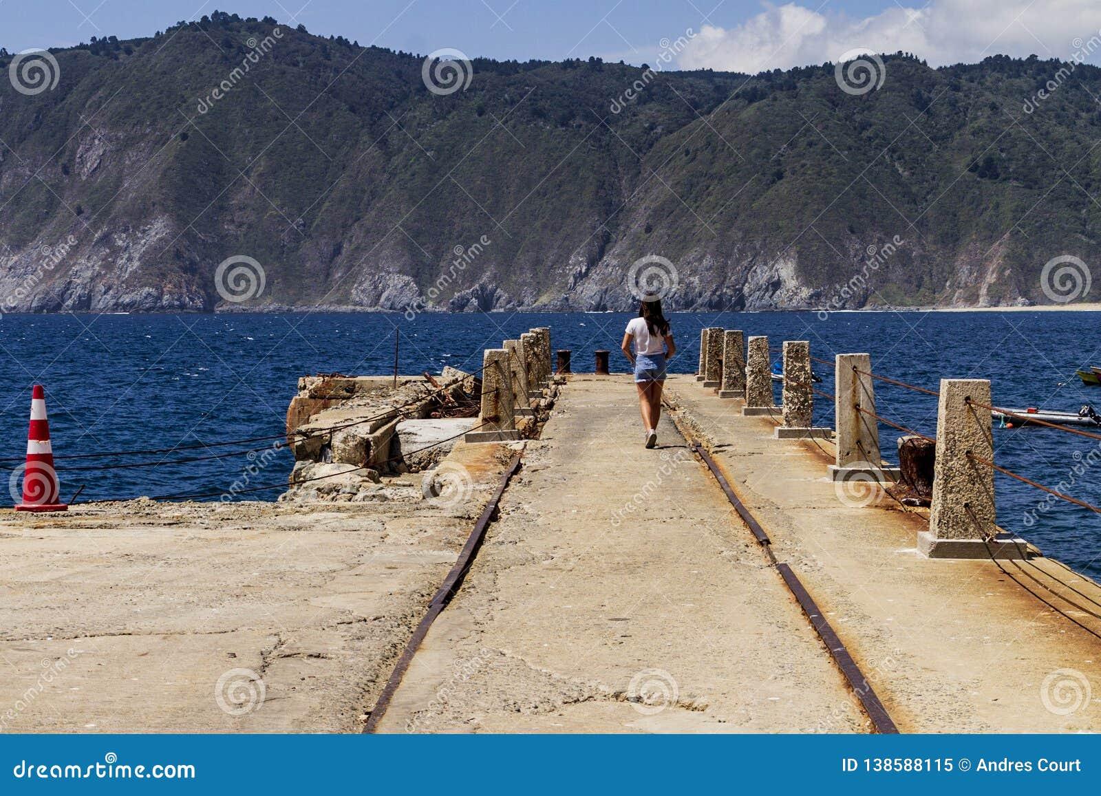 Young girl walking in pier