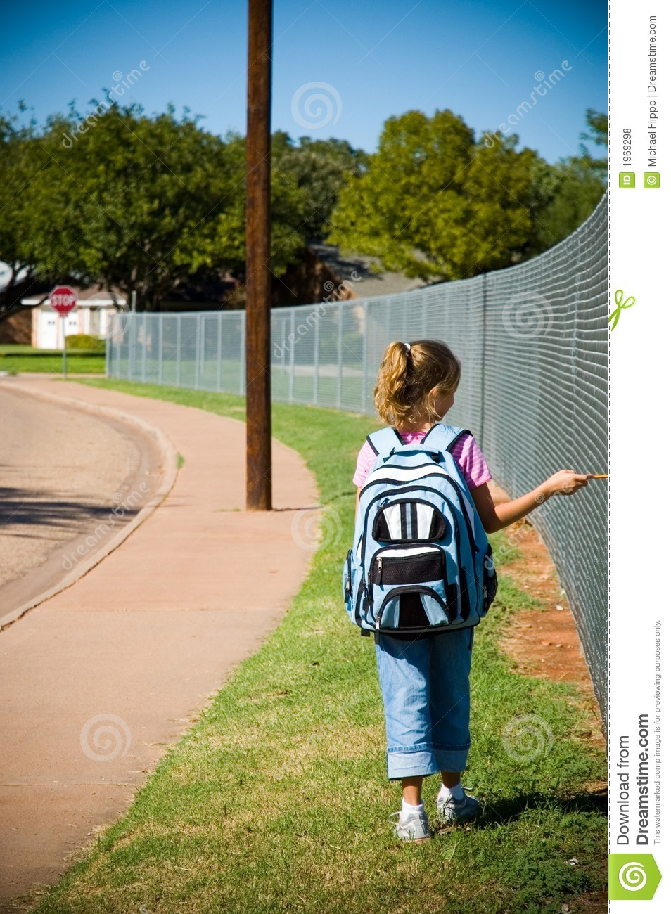 Young Girl Walking To School On First Day Of School Stock
