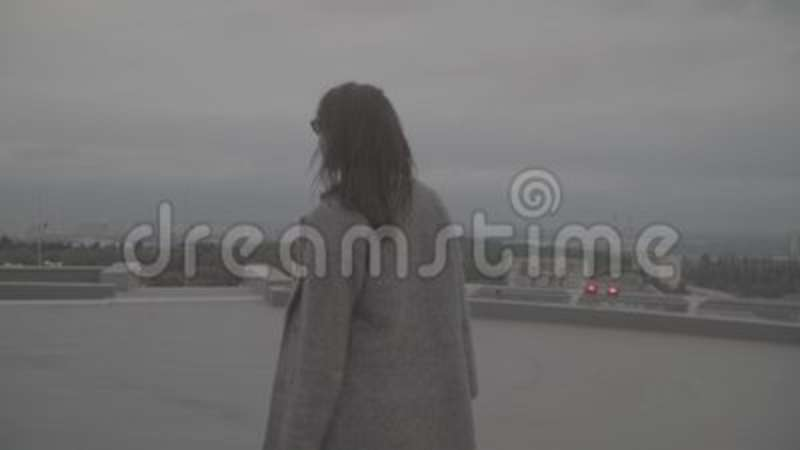 Young girl in windy weather outdoors  Slow motion, s-log, ungraded