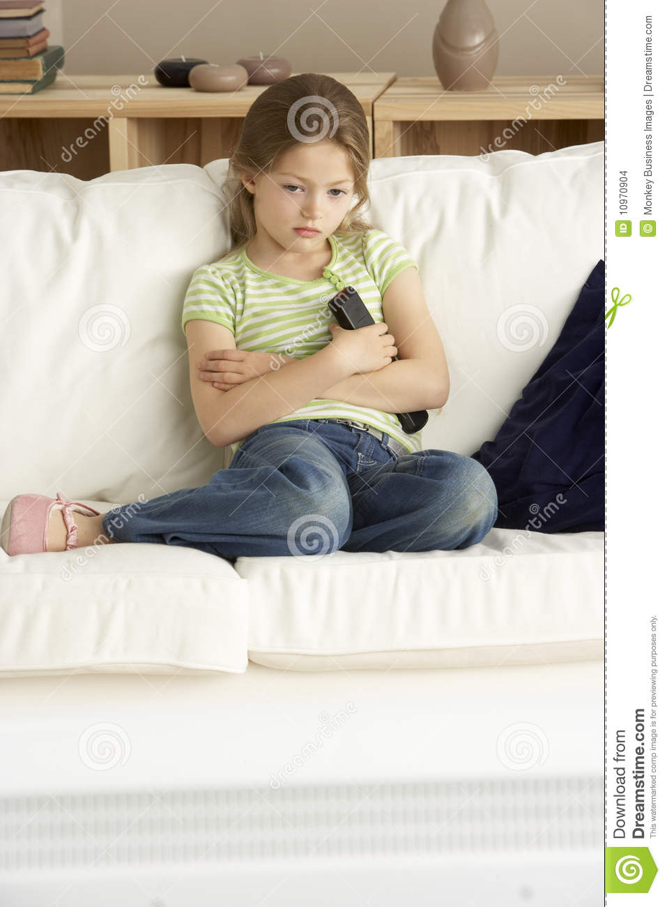 Young Girl Watching Television At Home Stock Images