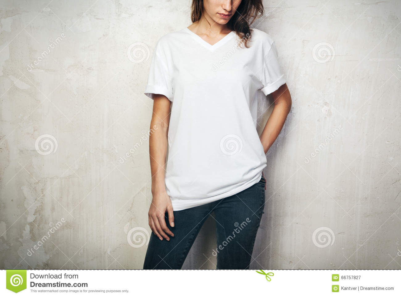 Young Girl Wearing Blank T-shirt And Black Jeans. Concrete ...