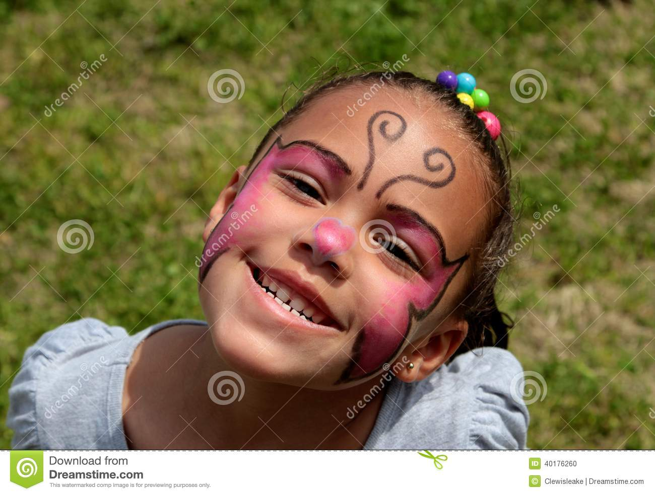 Young Girl Wearing Face Paint and Smiling Brightly