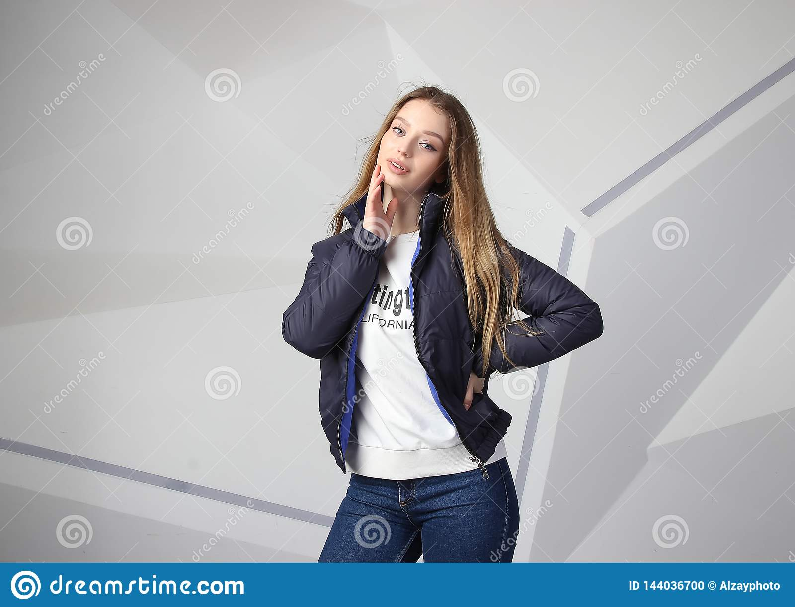 Young girl girl wearing  jacket with area for your logo, mock-up of white women hoodie