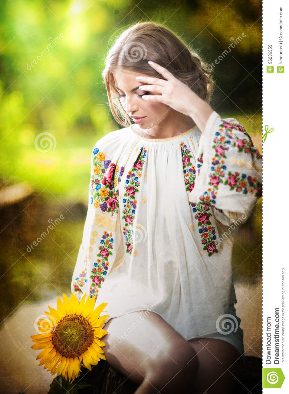 Young Girl Models Nn: Young Girl Wearing Romanian Traditional Blouse Holding A