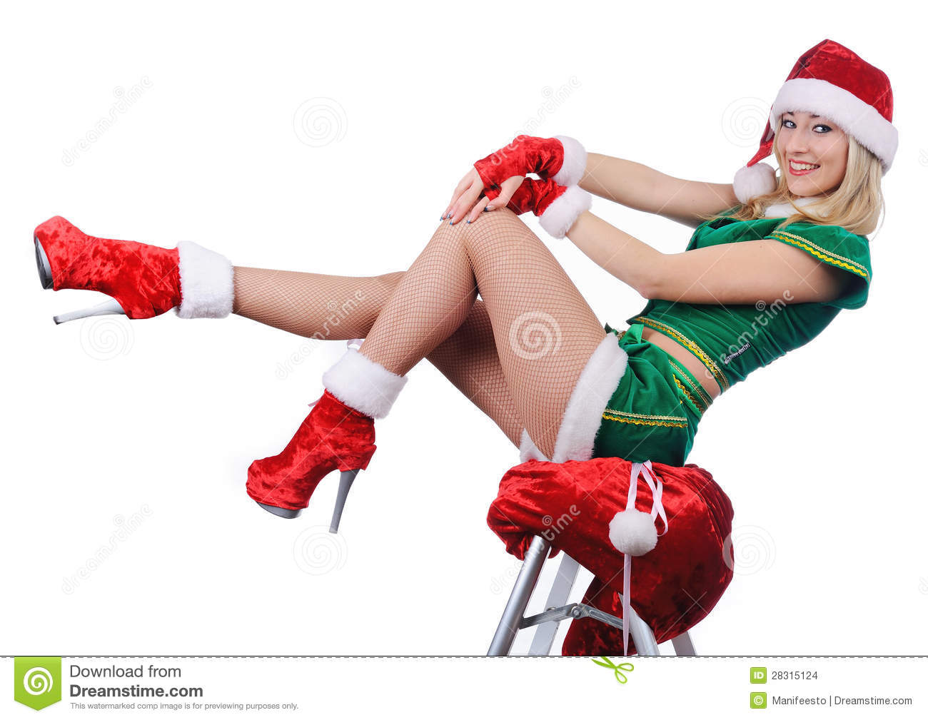 Young girl wearing santa claus clothes and high heels