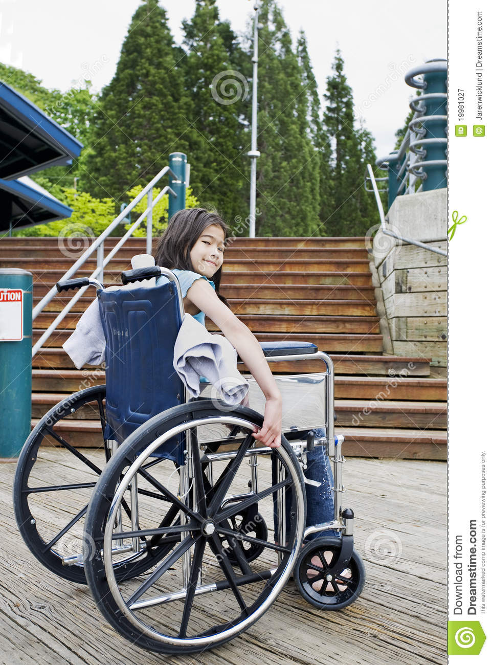 Young Girl In Wheelchair In Front Of Stairs Royalty Free