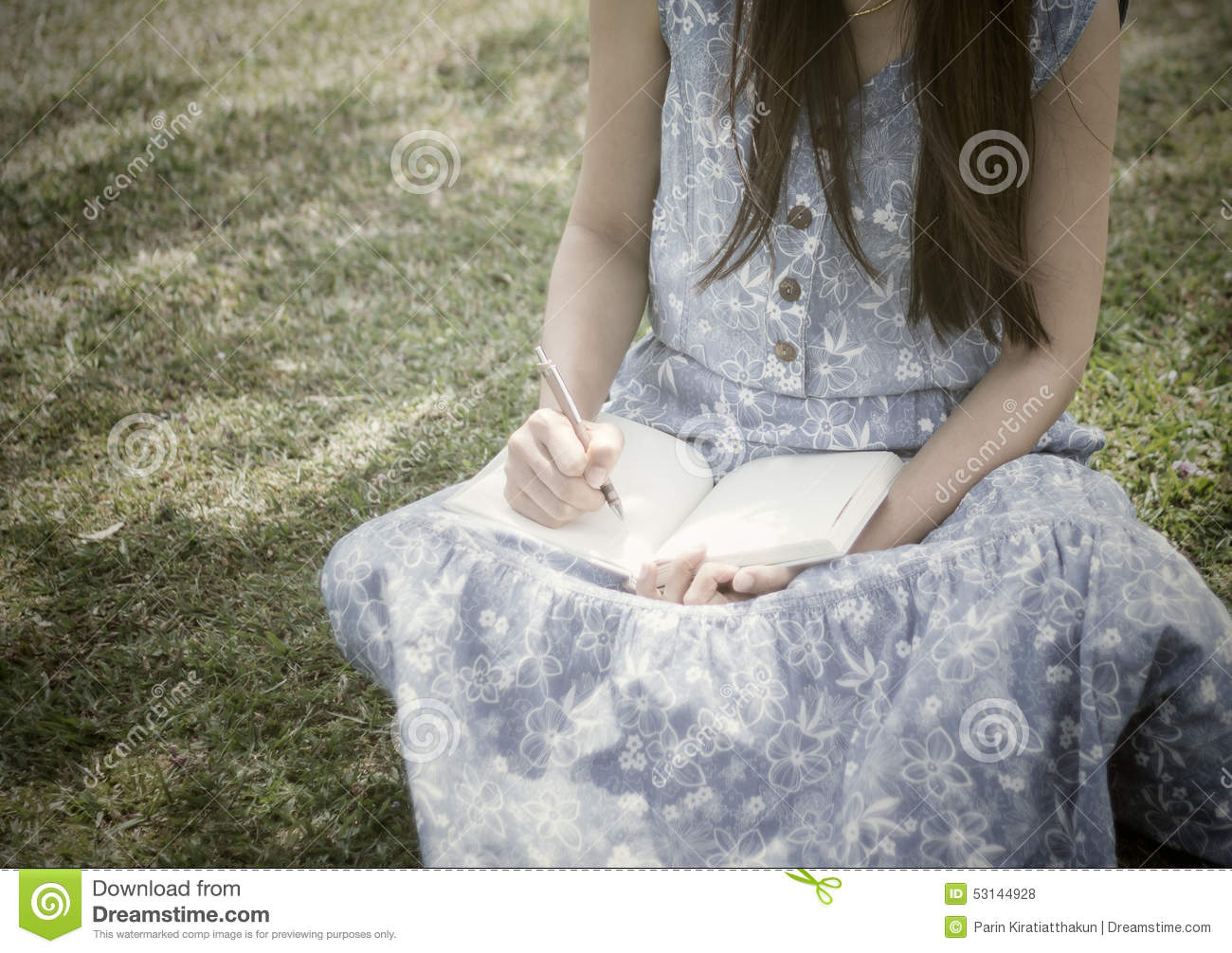 young girl writing into her diary stock photo - image of college