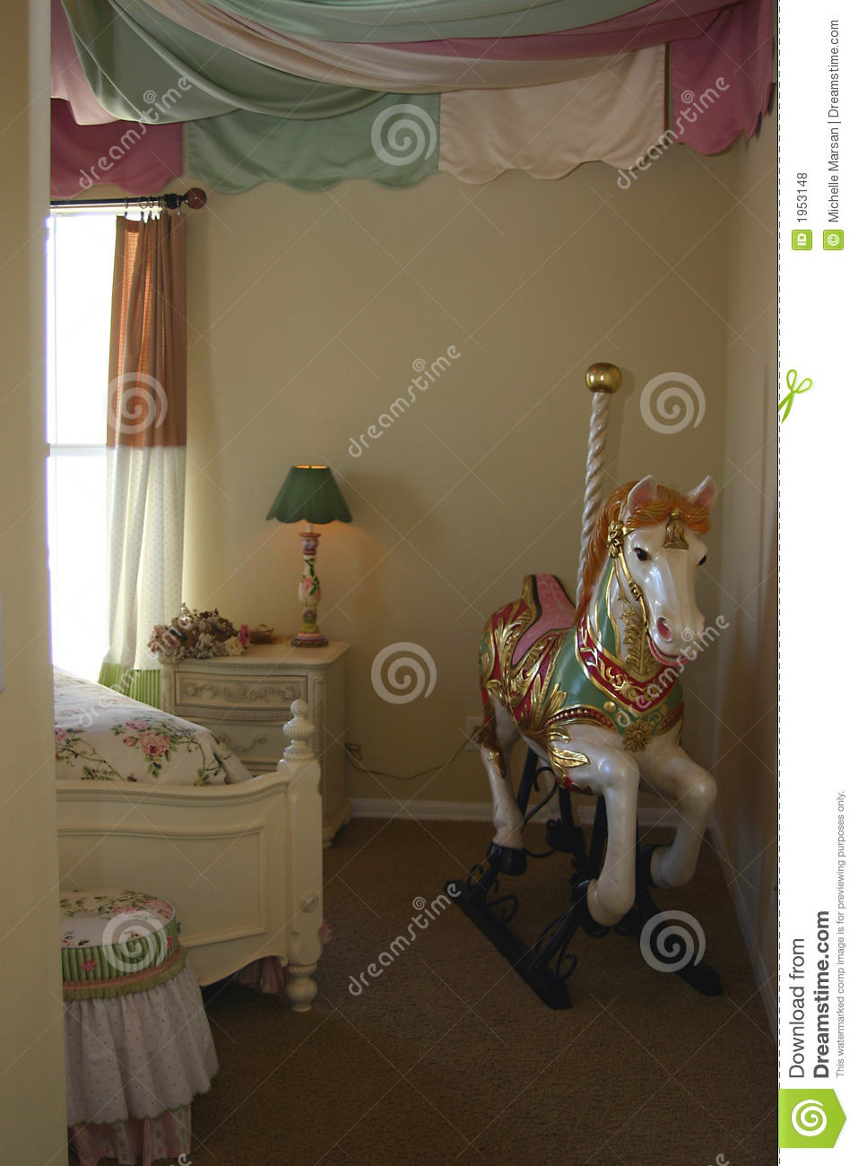 Young Girls Bedroom With Carousel Horse Stock Photo