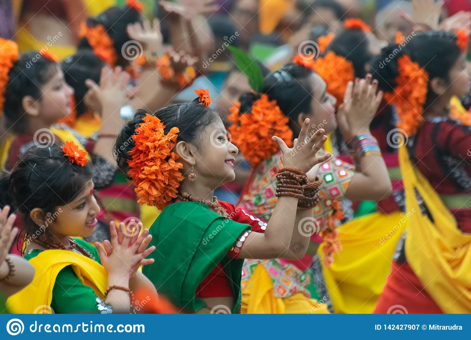 Young girls dancing at Holi / spring festival