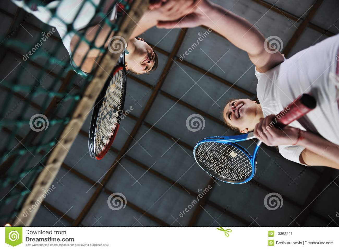 Young girls playing tennis game indoor