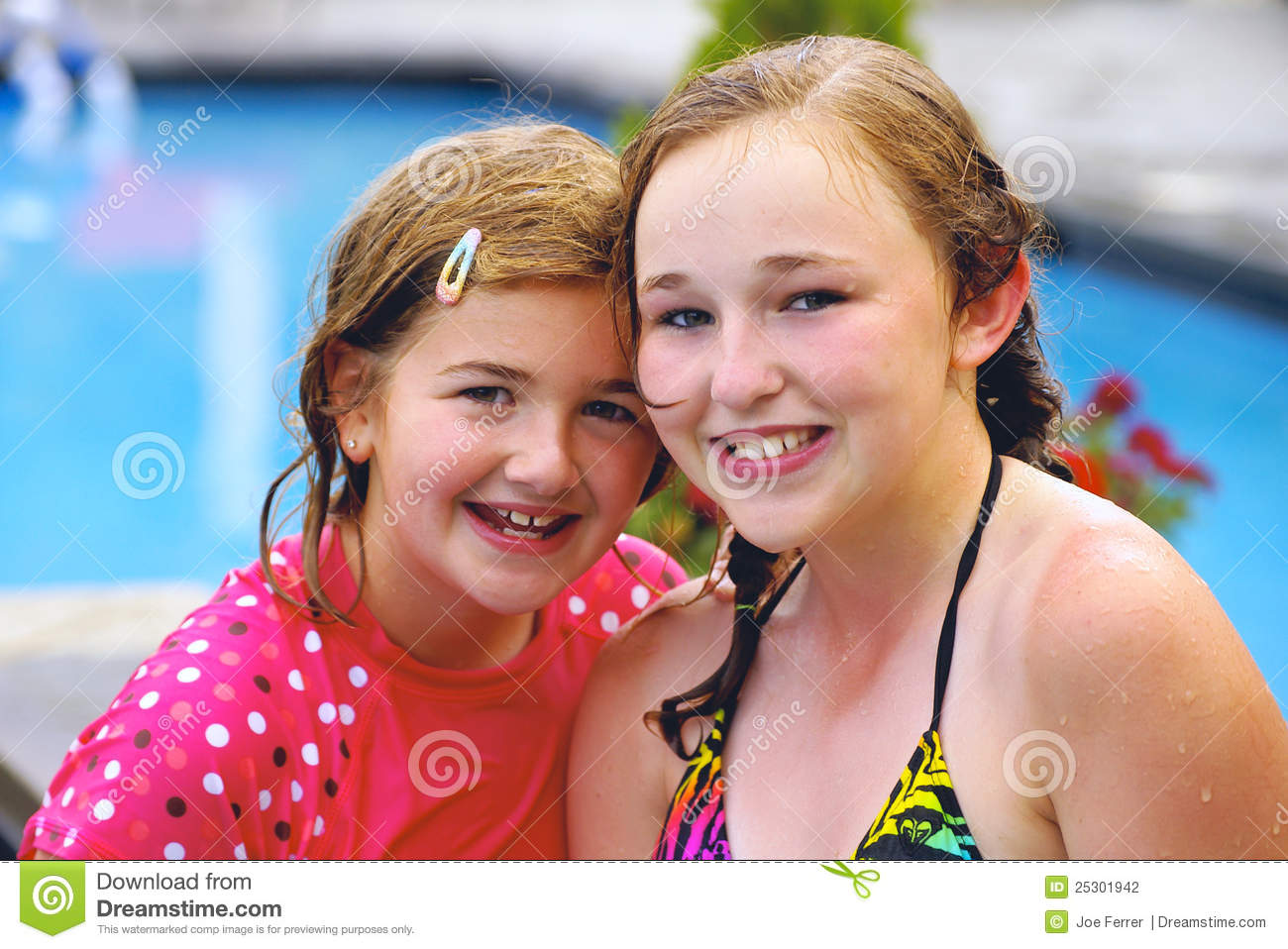 Young Girls Smiling at Pool Side