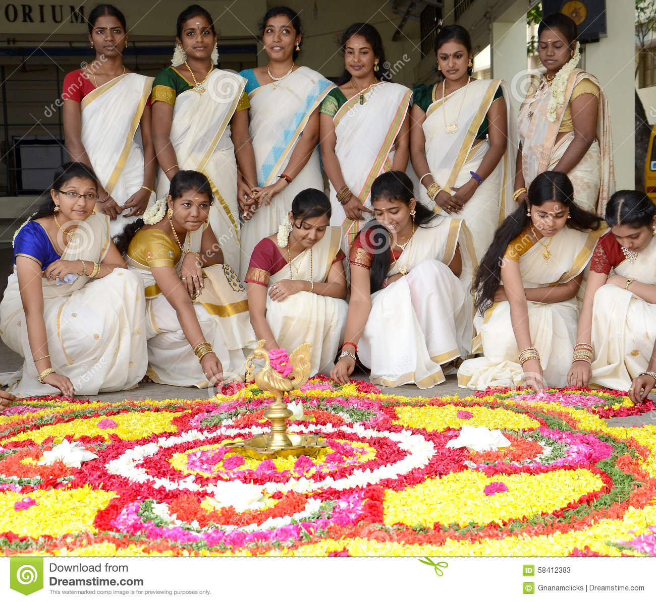 5a8324a4e7730 Beautiful young girls in traditional dress, making rangoli for South Indian  festival, Happy Onam celebration.photo taken on:22nd august 2015