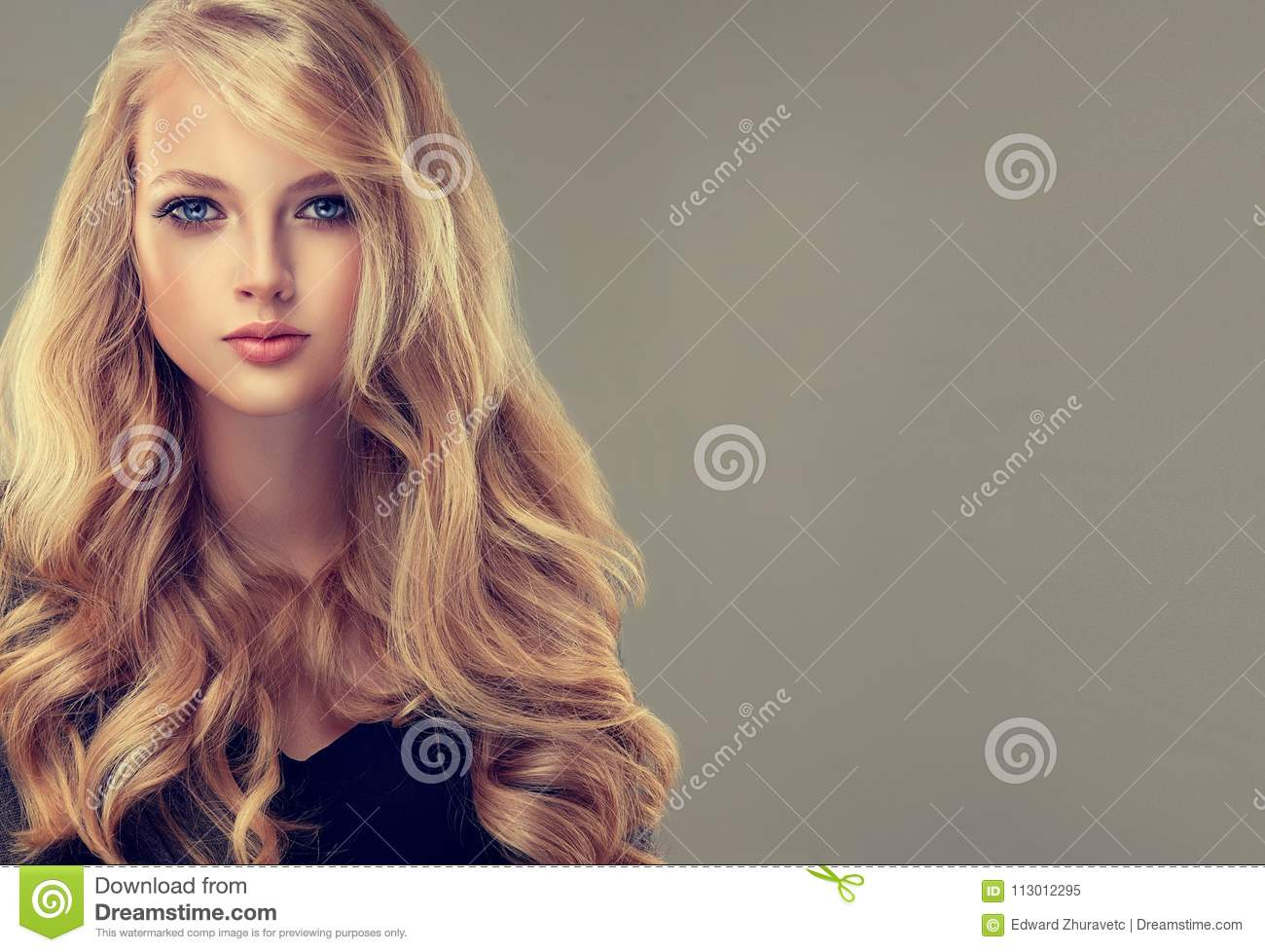Golden Haired Woman With Voluminous, Shiny And Curly Hairstyle ...