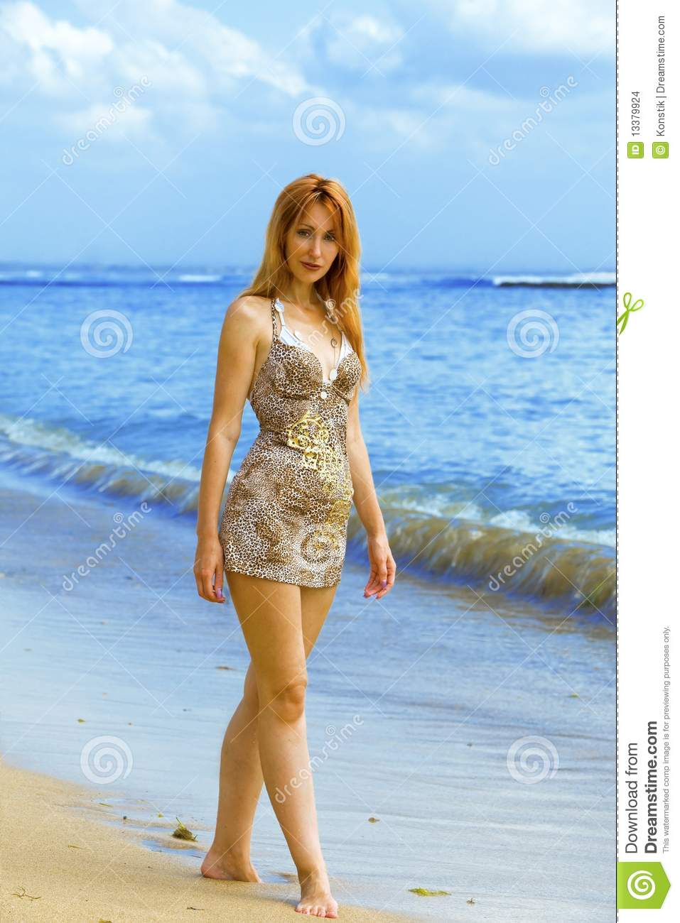 young graceful woman goes on oceanside stock images   image 13379924