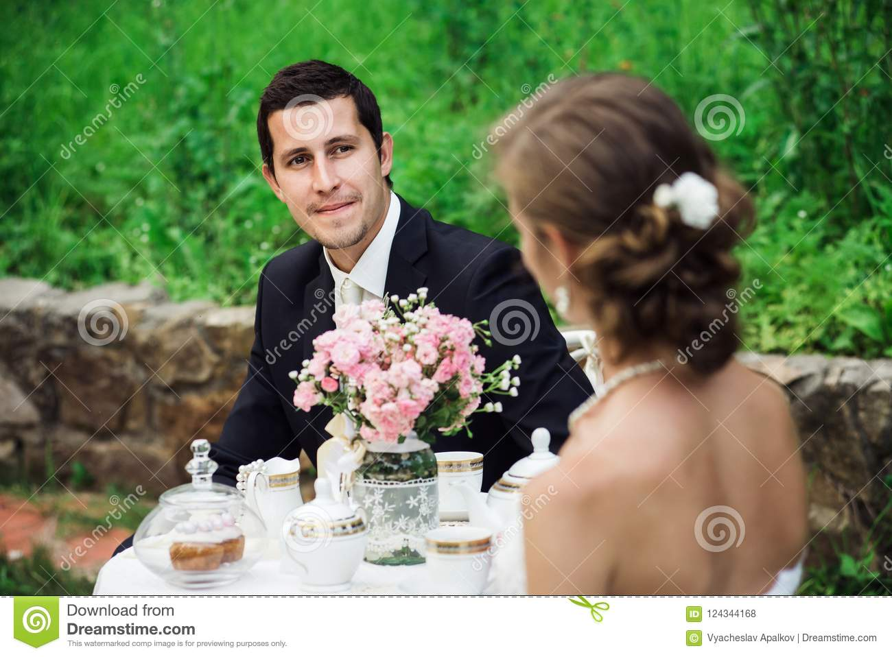 Young groom looking delighted at his bride