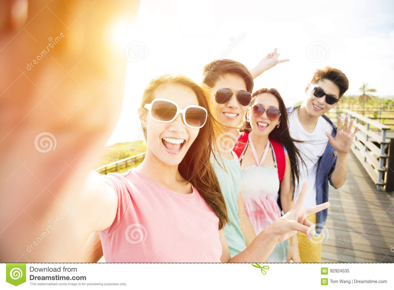 Young group friends taking selfie on summer vacation