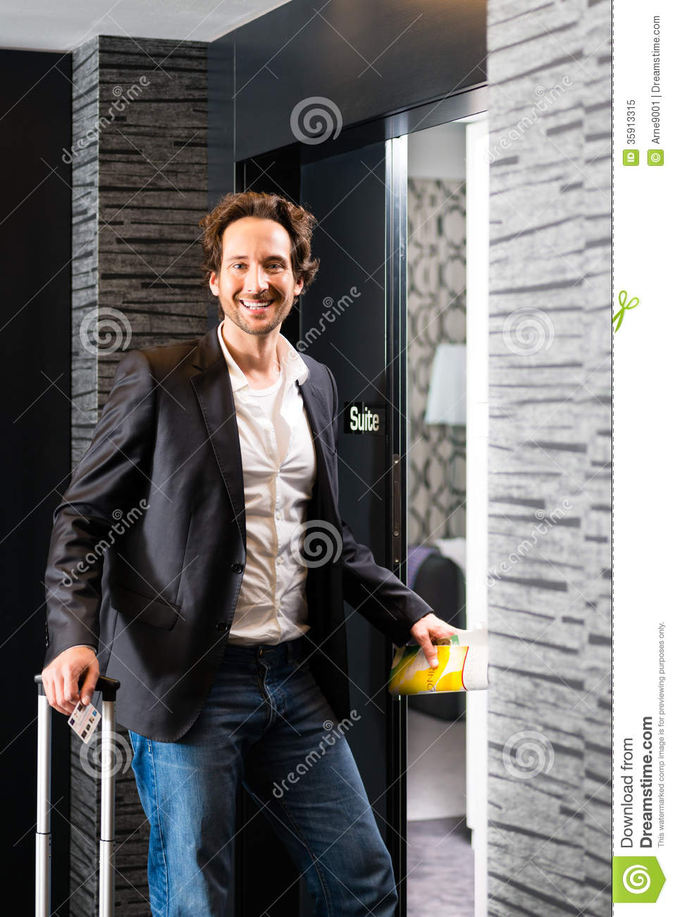 Inside Hotel Room Door: Young Guest With Luggage Entering Hotel Room Stock Image