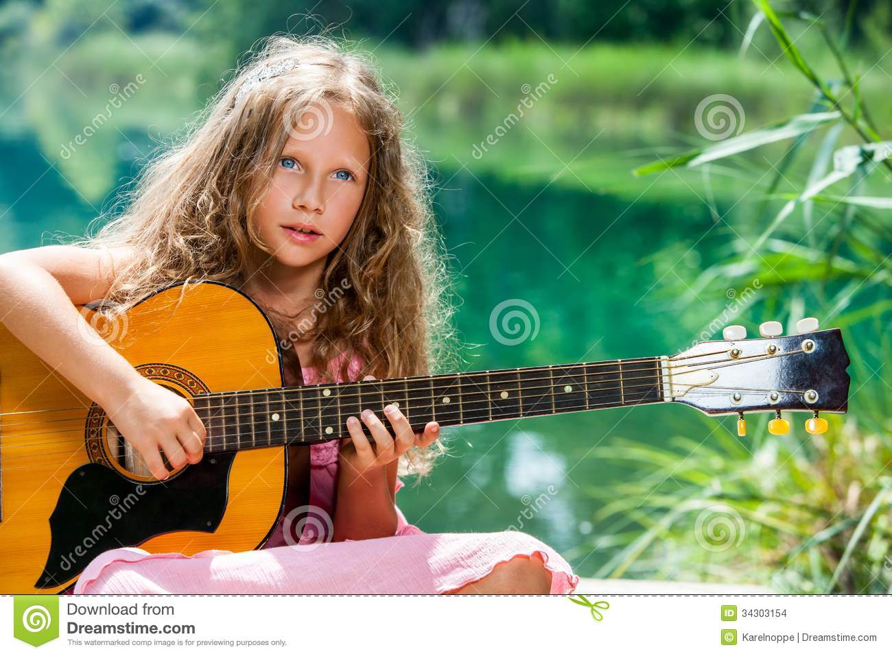 girl playing spanish guitar