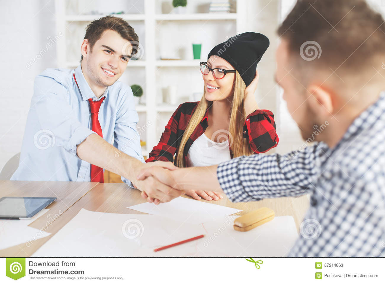 Young guy accepted for a job