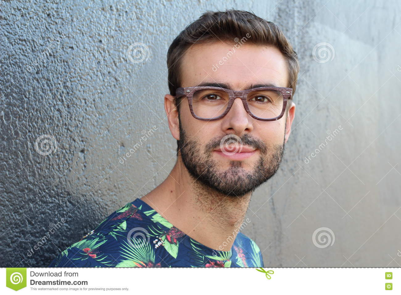 Young Guy With A Beard And Mustache With Glasses Posing On ...