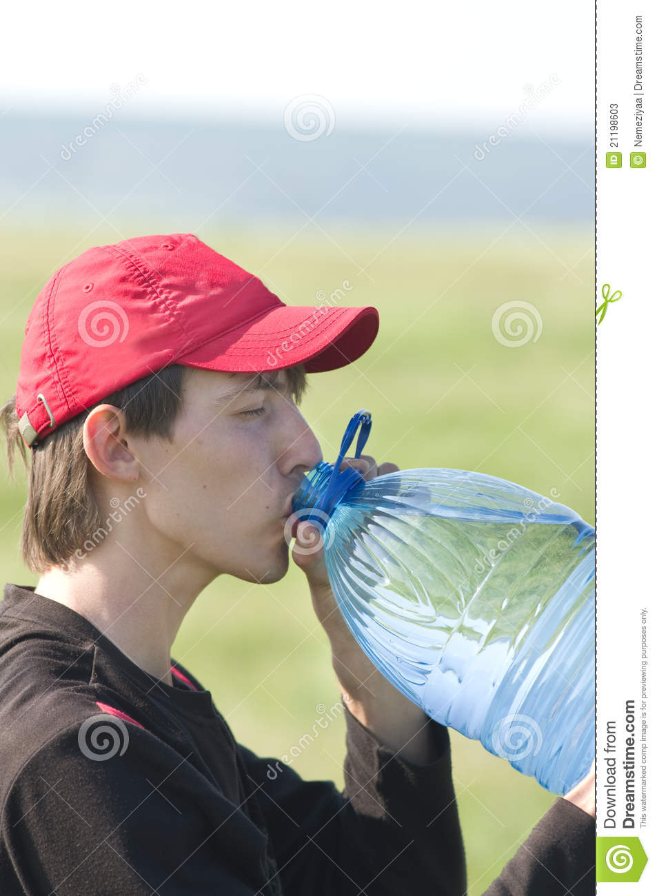 Young guy drinking water