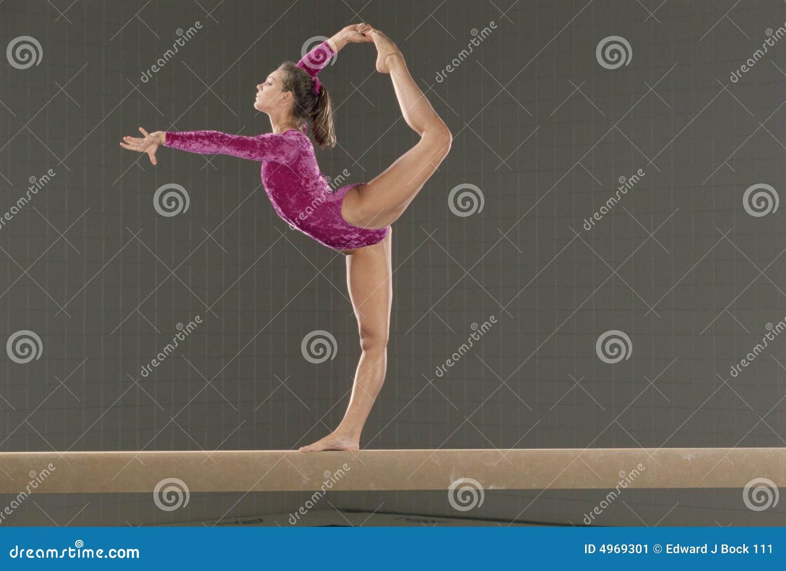 Young gymnast on balance beam