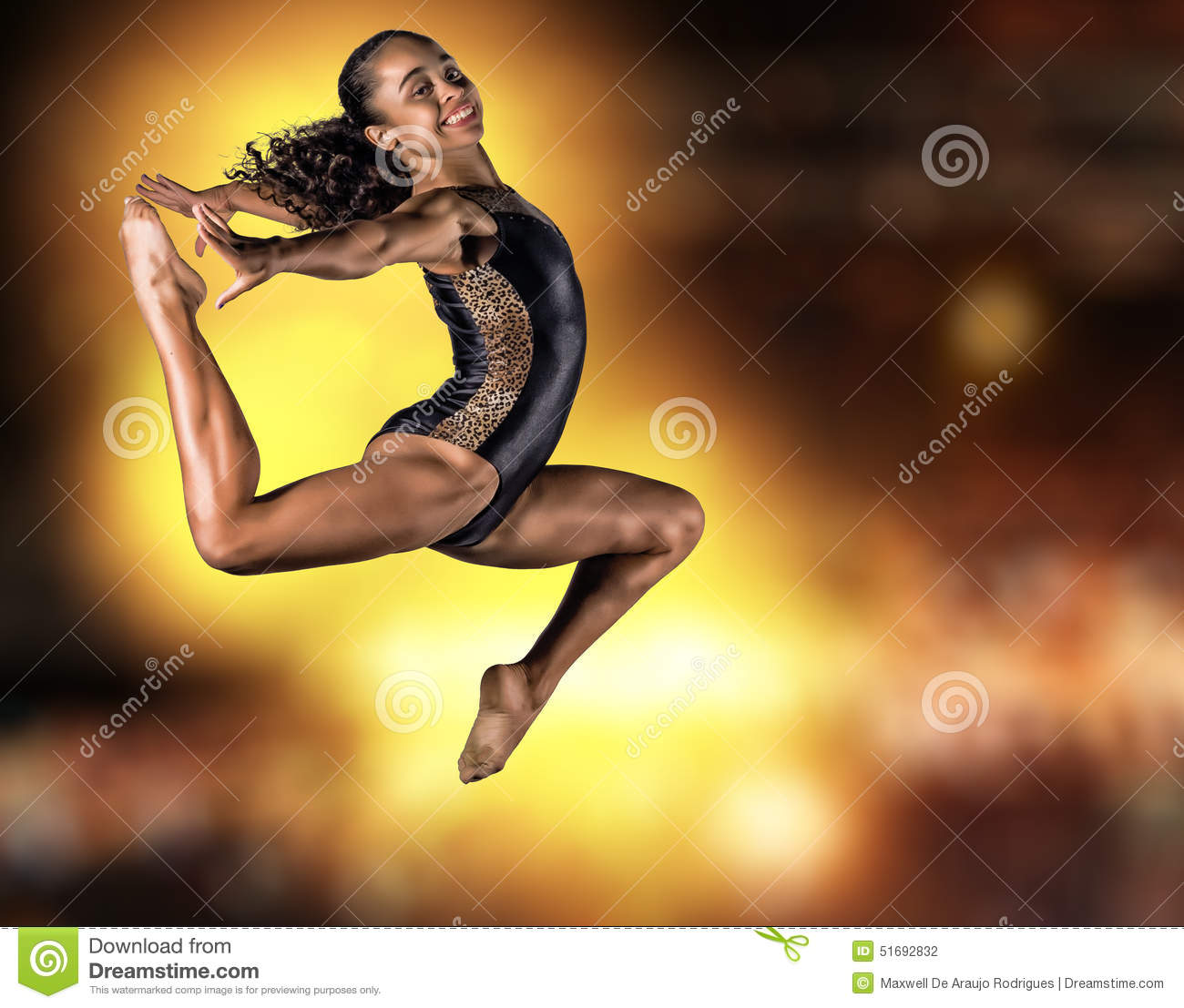 Young gymnast girl jumping