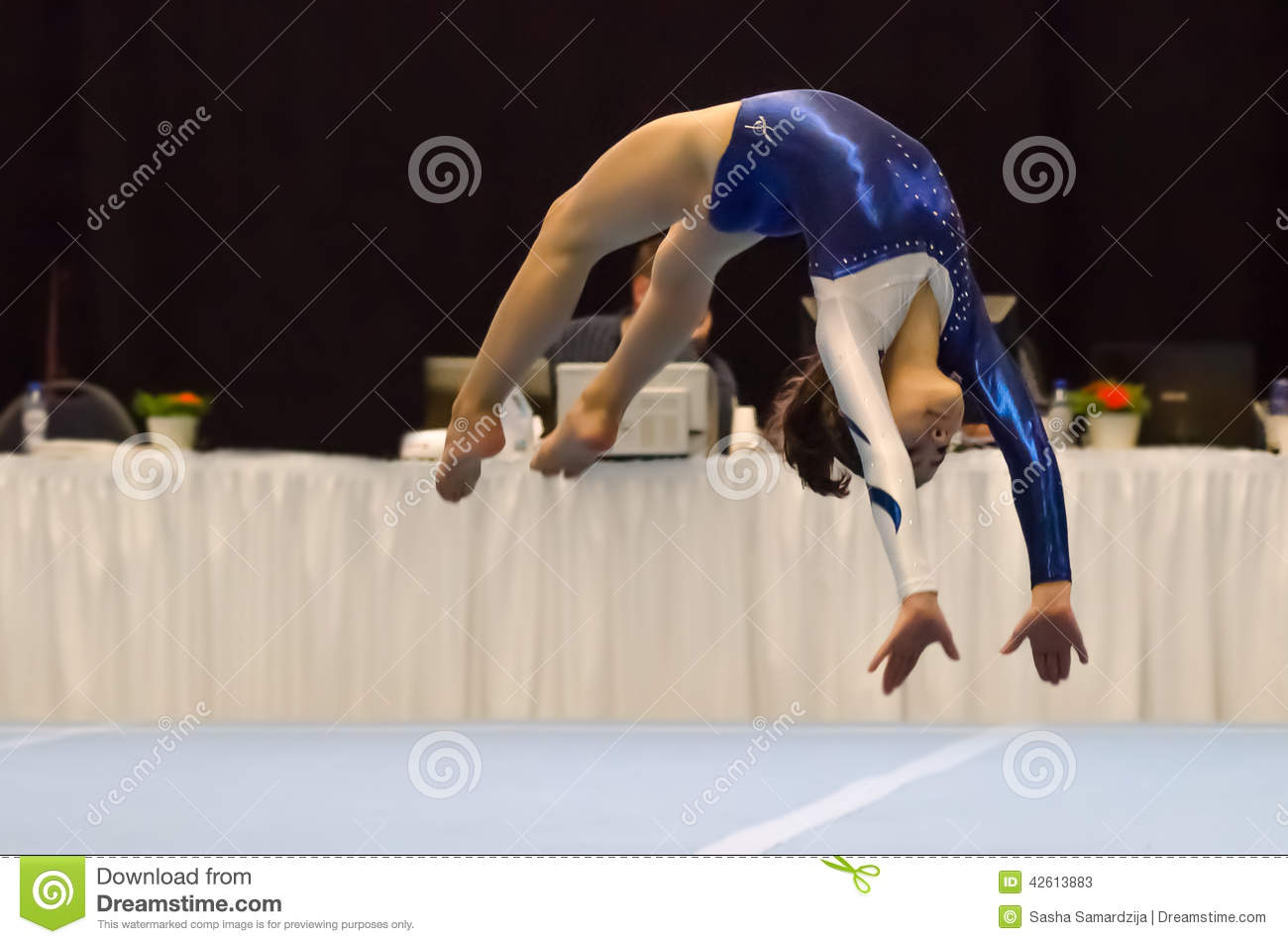 Back Handspring Of Female Gymnast In Sunset Sky Stock