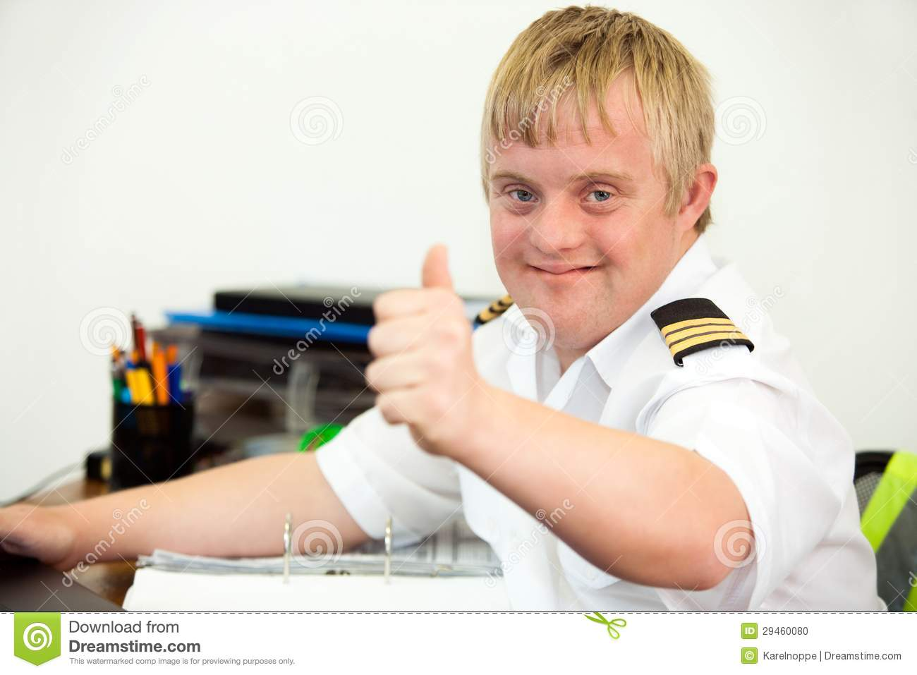 young handicapped pilot showing thumbs up office 29460080 portrait of young pilot with down syndrome at desk stock image