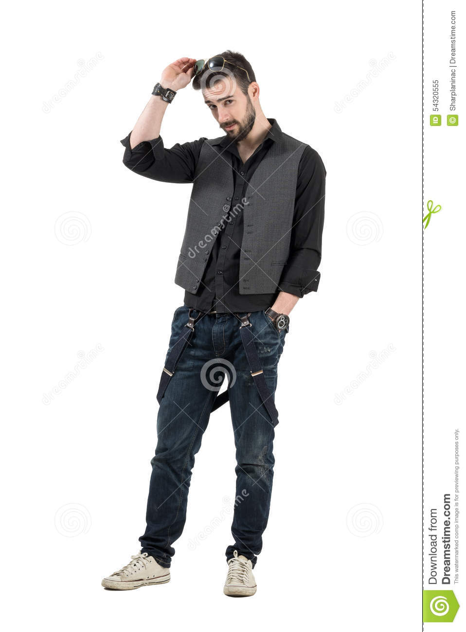 Young handsome bearded man putting sunglasses on his head