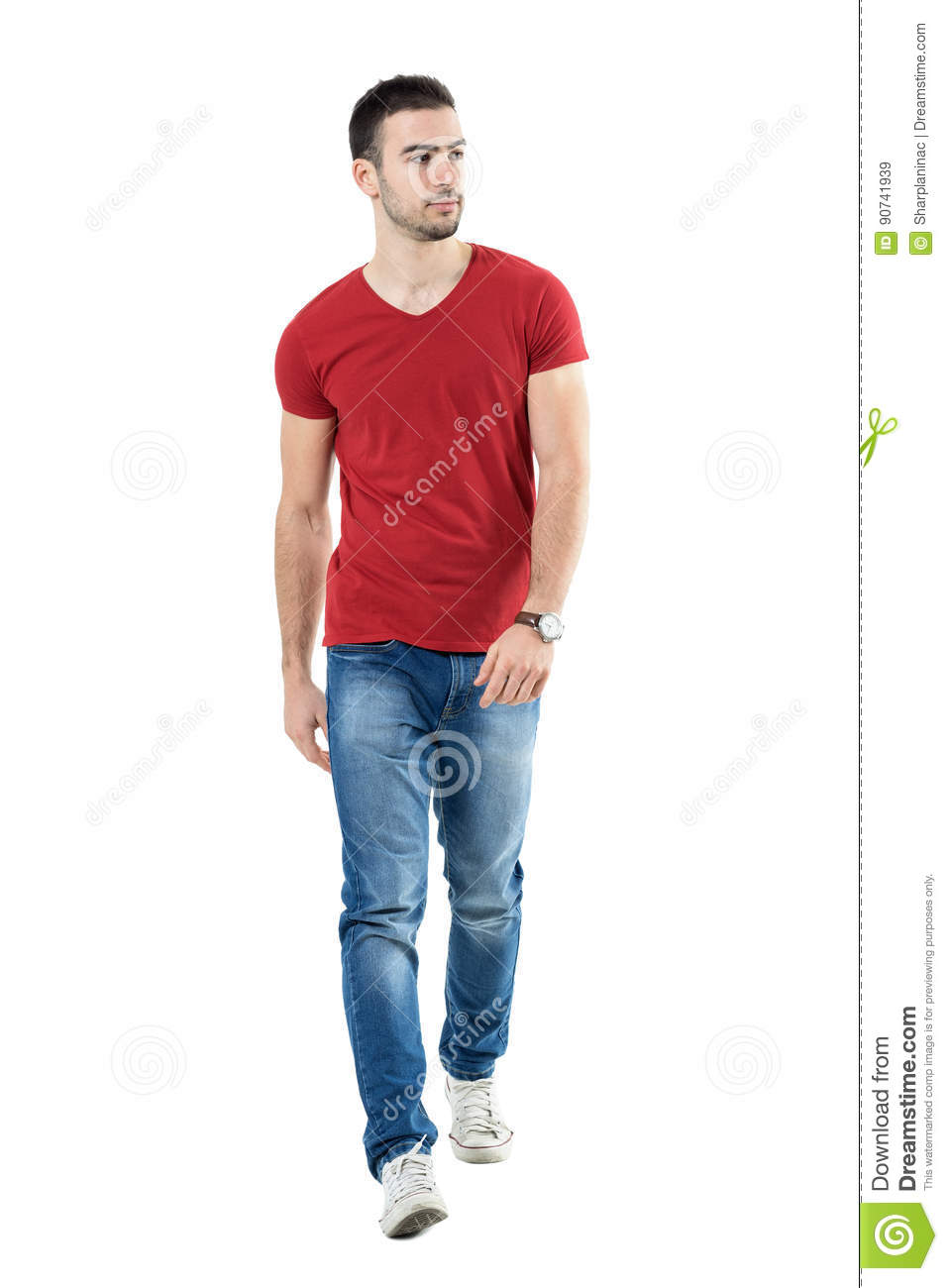 Young handsome casual man walk towards camera looking away