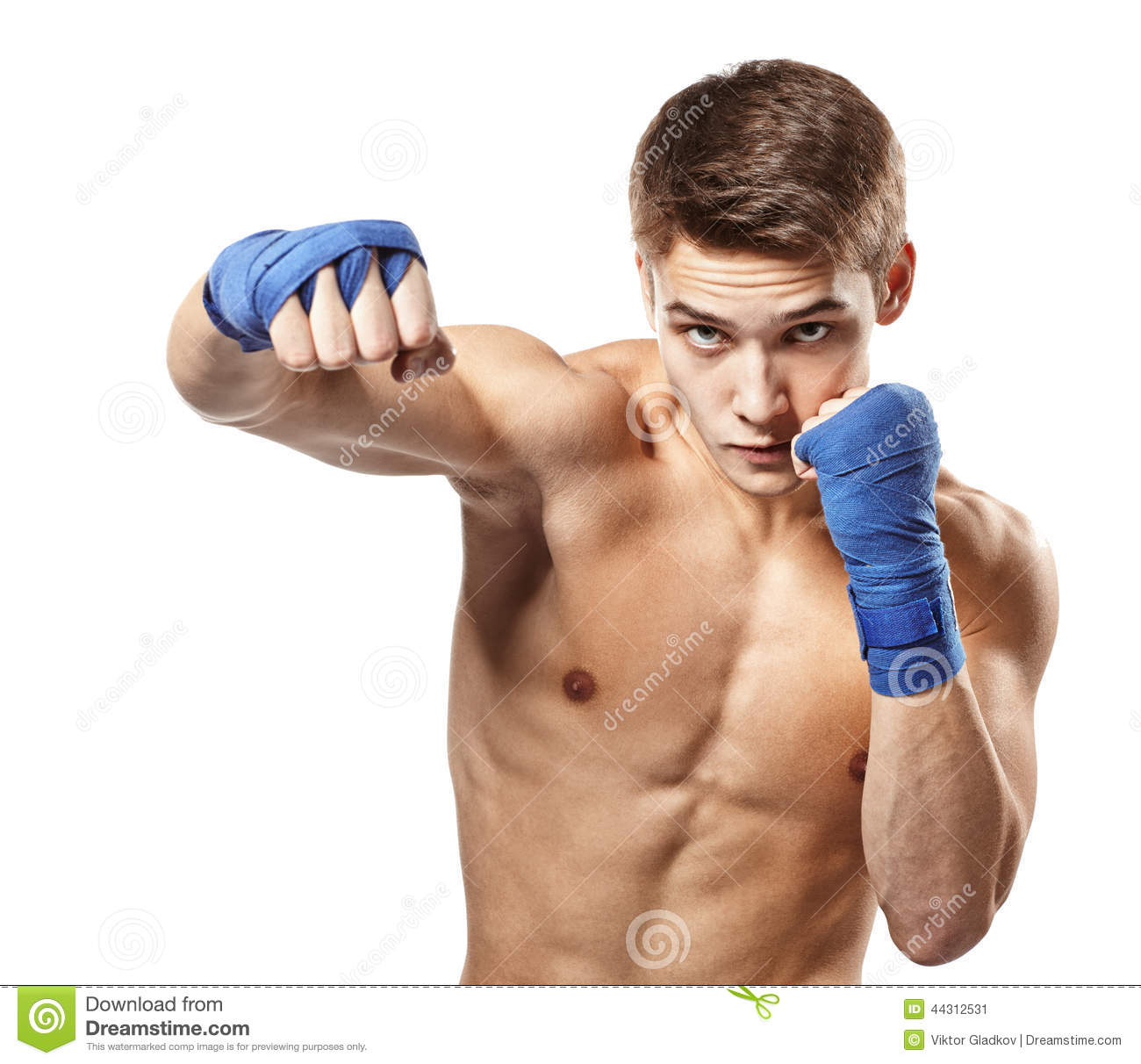 Young handsome male boxer making punches