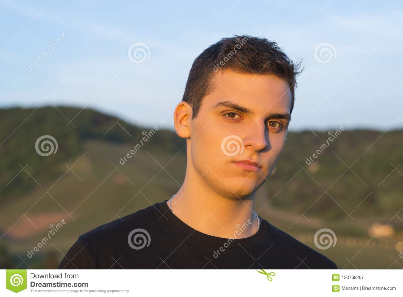 Young Handsome Man With Brown Eyes Looking At The Camera At Sunset