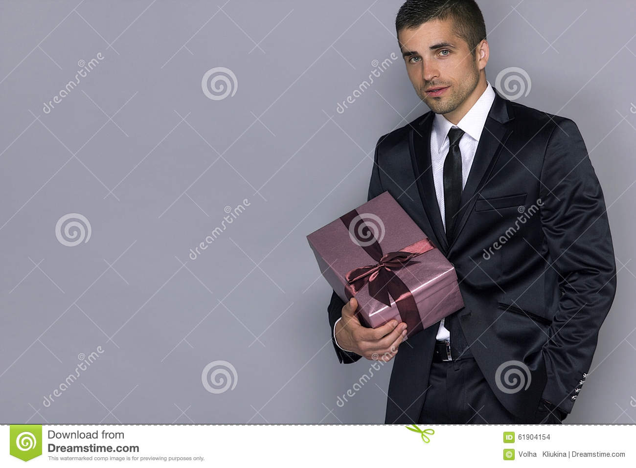 Gifts For Young Men: Young Handsome Man With A Gift Stock Photo