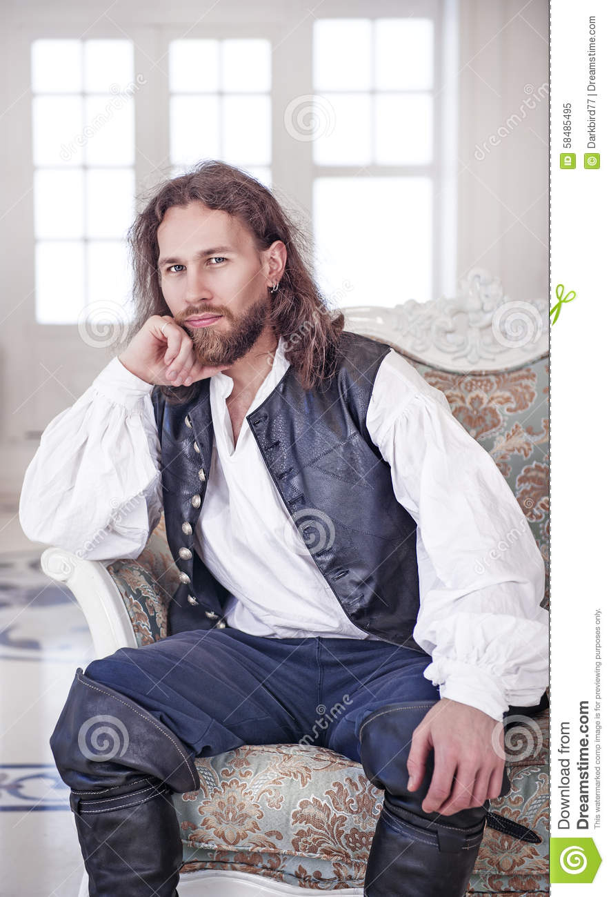young handsome man in medieval clothes stock photo image
