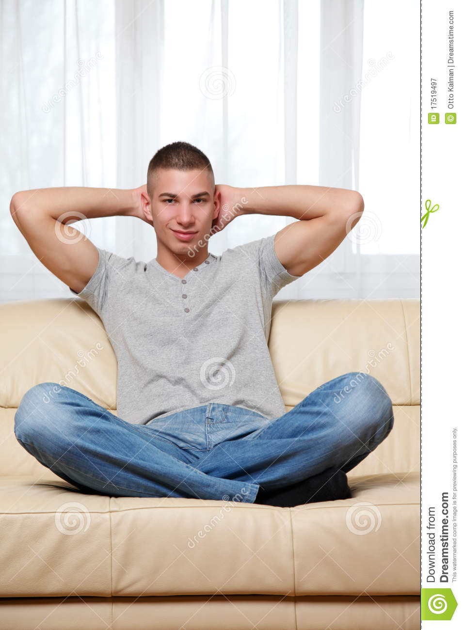 Young Handsome Man Relaxing At Home Royalty Free Stock